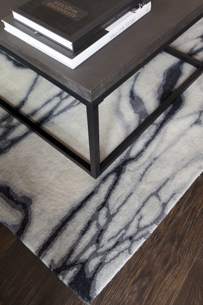 Rug inspired by the swirling patterns of light dancing on water